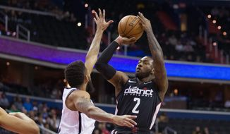 Wizards guard John Wall's four-year, $169 million supermax contract extension kicks in next season, meaning his contract could be hard to move. (ASSOCIATED PRESS)