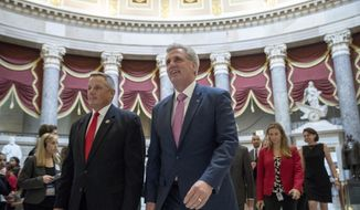 Then-House Majority Leader Kevin McCarthy of Calif., center, and Rep. Bruce Westerman, R- Ark., left, walk to the House floor on Capitol Hill in Washington, Wednesday, June 27, 2018. (AP Photo/Andrew Harnik) ** FILE **