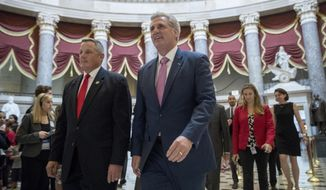 House Majority Leader Kevin McCarthy of Calif. (center) and Rep. Bruce Westerman, Arkansas Republican, (left) walk to the House floor on Capitol Hill in Washington. (AP Photo/Andrew Harnik)