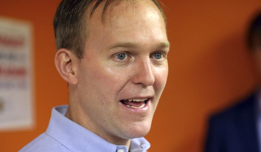 In this Saturday, Nov. 3, 2018, photo, Salt Lake County Mayor Ben McAdams speaks with volunteers before a get out to vote, in Millcreek, Utah. Mia Love, the first black female Republican in Congress, is trying to hold off a major challenge from McAdams. (AP Photo/Rick Bowmer)