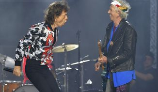 In this May 25, 2018 file photo, Mick Jagger, left, and Keith Richards, of The Rolling Stones, perform during their No Filter tour in London. The Rolling Stones will be rolling through the U.S. next year. The band says it is adding a 13-show leg to its tour in spring 2019, kicking off in Miami on April 20. (Photo by Mark Allan/Invision/AP, File)