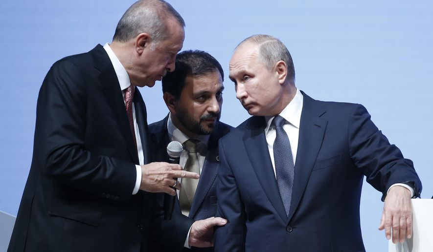 Russian President Vladimir Putin, right, listens to Turkey's President Recep Tayyip Erdogan through an interpreter, as they attend an event marking the completion of one of the phases of the Turkish Stream natural gas pipeline, in Istanbul, Monday, Nov. 19, 2018. (AP Photo/Lefteris Pitarakis)