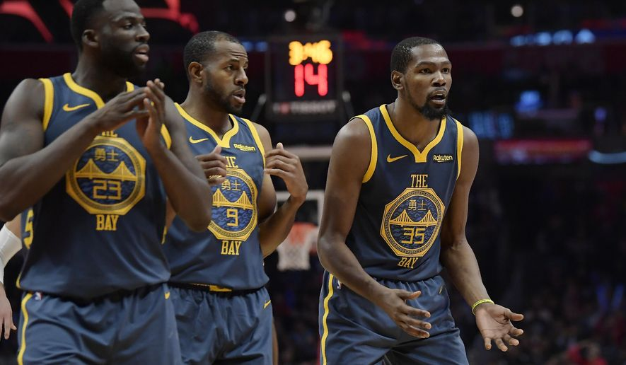 FILE - In this Nov. 12, 2018, file photo, Golden State Warriors forward Kevin Durant, right, reacts as he fouls out of the game while forward Draymond Green, left, and guard Andre Iguodala stand nearby during overtime of an NBA basketball game against the Los Angeles Clippers in Los Angeles. The Clippers won 121-116. Green's public outburst at Durant during the Warriors' loss on Nov. 12 lingers. Now there is tension on a team that has managed to remain mostly drama-free during its run. (AP Photo/Mark J. Terrill, File)