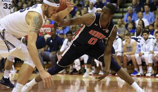 Xavier forward Zach Hankins (35) fights for a loose ball against Auburn forward Horace Spencer (0) during the first half of an NCAA college basketball game at the Maui Invitational, Monday, Nov. 19, 2018, in Lahaina, Hawaii. (AP Photo/Marco Garcia)
