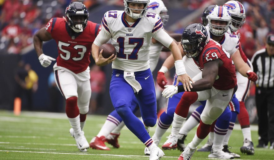 FILE - In this Oct. 14, 2018, file photo, Buffalo Bills quarterback Josh Allen (17) scrambles during the second half of an NFL football game against the Houston Texans, in Houston. Bills rookie Josh Allen is expected to be cleared to reclaim his starting job as Buffalo returns from its bye week to prepare to host Jacksonville on Sunday, Nov. 25. (AP Photo/Eric Christian Smith, File)