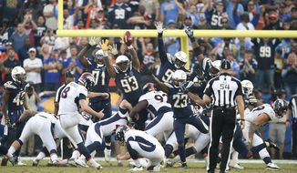 Denver Broncos kicker Brandon McManus (8) kicks the winning field goal during the second half of an NFL football game against the Los Angeles Chargers Sunday, Nov. 18, 2018, in Carson, Calif. (AP Photo/Kelvin Kuo)