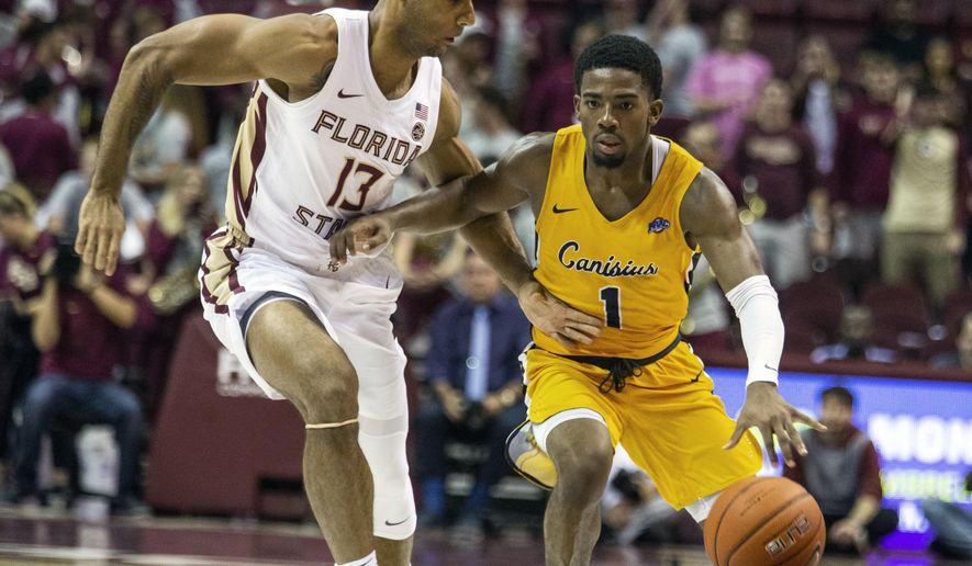 Canisius guard Malik Johnson brings the ball up the court against Florida State guard Anthony Polite in the first half of an NCAA college basketball game in Tallahassee, Fla., Monday, Nov. 19, 2018. (AP Photo/Mark Wallheiser)