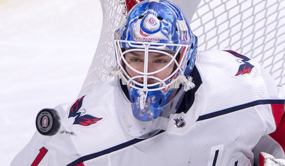 Washington Capitals goaltender Pheonix Copley (1) keeps his eyes on the puck during first period NHL hockey action against the Montreal Canadiens Monday, Nov. 19, 2018 in Montreal. (Ryan Remiorz/The Canadian Press via AP)