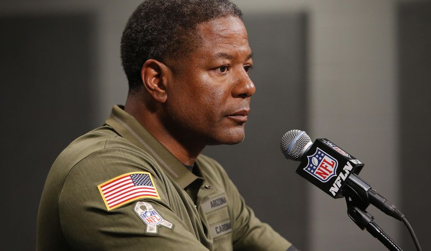 FILE - In this Nov. 18, 2018, file photo, Arizona Cardinals head coach Steve Wilks speaks after an NFL football game against the Oakland Raiders, in Glendale, Ariz. The Cardinals are reeling from their worst loss of a bad season, and the future doesn't look forgiving. (AP Photo/Rick Scuteri, File)