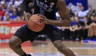 Duke forward RJ Barrett (5) looks for net over San Diego State during the first half of an NCAA college basketball game at the Maui Invitational, Monday, Nov. 19, 2018, in Lahaina, Hawaii. (AP Photo/Marco Garcia)