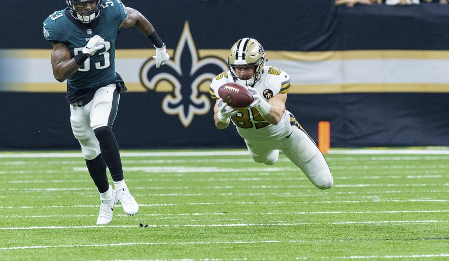 New Orleans Saints tight end Dan Arnold makes a diving catch during an NFL football game against the Philadelphia Eagles on Sunday, Nov. 18, 2018. (Scott Clause/The Daily Advertiser via AP)