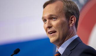 In this Oct. 15, 2018, file photo, Salt Lake County Mayor Ben McAdams answers a question as he and U.S. Rep. Mia Love participate in a debate in Sandy, Utah, as the two battle for Utah's 4th Congressional District. McAdams declared victory Monday, Nov. 19, 2018, in the tight race, but Love didn't concede and The Associated Press has not called the race. (Scott G Winterton/Deseret News, via AP, Pool, File)
