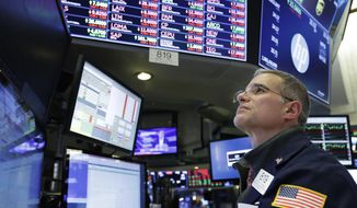 Trader Anthony Rinaldi follows stock activity, Monday, Nov. 19, 2018, at the New York Stock Exchange. Big technology and internet companies came under heavy selling pressure again on Monday, leading to broad losses across the stock market. The Dow Jones Industrial Average briefly fell 500 points. (AP Photo/Mark Lennihan)