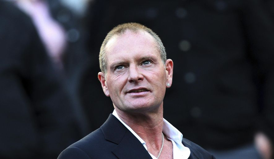 FILE - In this Oct. 16, 2011 file photo, Paul Gascoigne attends the English Premier League soccer match between Newcastle United and Tottenham Hotspur at St James' Park, Newcastle, England. Former England midfielder Paul Gascoigne has been charged with sexually assaulting a woman on board a train. Gascoigne is to appear at a nearby court on Dec. 11, 2018. (AP Photo/Scott Heppell, File)