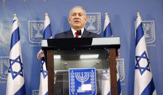 Israeli Prime Minister Benjamin Netanyahu delivers a statement in Tel Aviv, Israel, Sunday, Nov. 18, 2018. Netanyahu says he will take over temporarily as defense minister as early elections still loom. (AP Photo/Ariel Schalit) ** FILE **