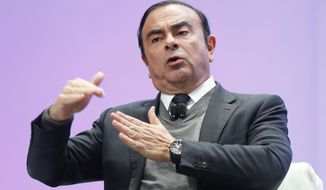 FILE - In this Jan. 9, 2017, file photo, Carlos Ghosn, Chairman of the Board and Chief Executive Officer of Nissan Motor Co., Ltd., speaks at the North American International Auto Show in Detroit. Japanese media are reporting Monday, Nov. 19, 2018, that Ghosn is being questioned by Tokyo prosecutors on suspicion he falsified his financial reports. (AP Photo/Paul Sancya, File)
