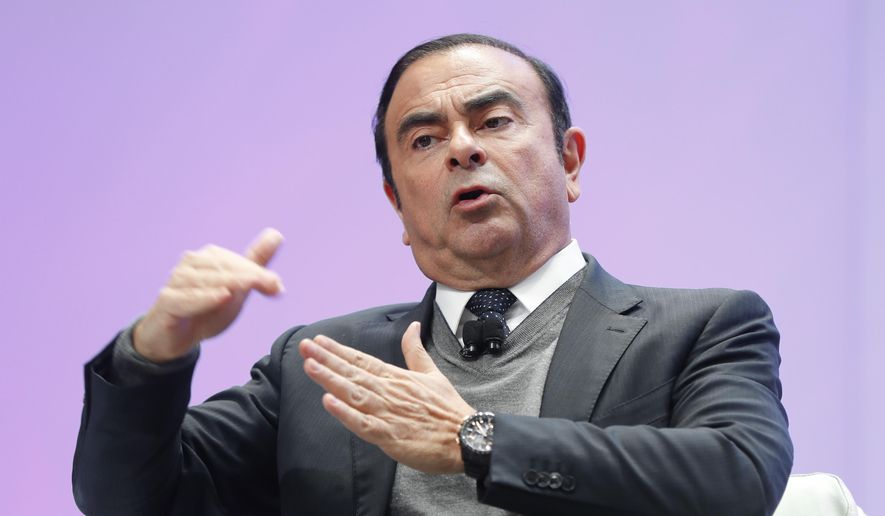 In this Jan. 9, 2017, file photo, Carlos Ghosn, chairman of the board and chief executive officer of Nissan Motor Co., Ltd., speaks at the North American International Auto Show in Detroit. Japanese media are reporting Monday, Nov. 19, 2018, that Ghosn is being questioned by Tokyo prosecutors on suspicion he falsified his financial reports. (AP Photo/Paul Sancya, File)