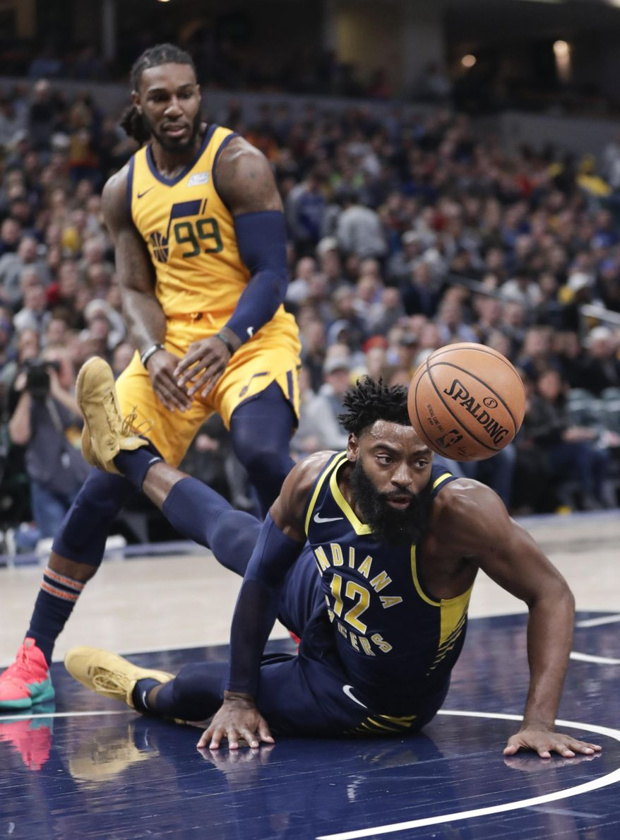 Indiana Pacers guard Tyreke Evans (12) loses the ball after falling in front of Utah Jazz forward Jae Crowder (99) during the first half of an NBA basketball game in Indianapolis, Monday, Nov. 19, 2018. (AP Photo/Michael Conroy)