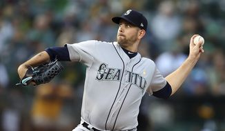 FILE - In this Saturday, Sept. 1, 201 file photo ,Seattle Mariners pitcher James Paxton works against the Oakland Athletics during the first inning of a baseball game in Oakland, Calif. A person familiar with the negotiations tells The Associated Press the New York Yankees have agreed to acquire left-hander James Paxton from the Seattle Mariners for left-hander Justus Sheffield and two other prospects, Monday, Nov. 19, 2018. (AP Photo/Ben Margot, File) **FILE**