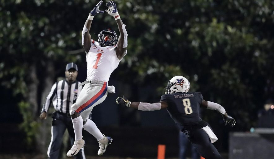 Mississippi wide receiver A.J. Brown (1) catches a pass as he is defended by Vanderbilt cornerback Joejuan Williams (8) in the second half of an NCAA college football game Saturday, Nov. 17, 2018, in Nashville, Tenn. Vanderbilt won 36-29 in overtime. (AP Photo/Mark Humphrey)