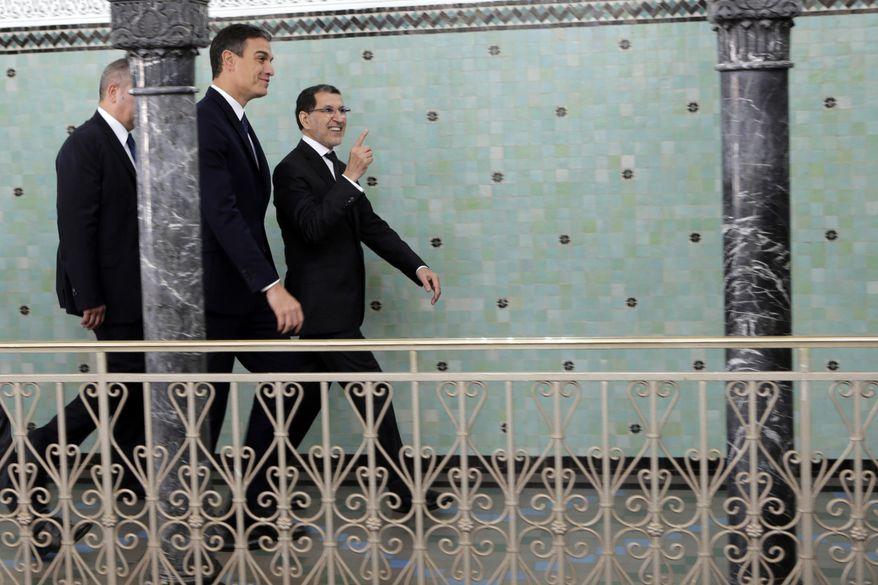 Morocco's Prime Minister Saad Eddine el-Othmani, right, greets his Spanish counterpart Pedro Sanchez prior to their meeting, in Rabat, Morocco, Monday, Nov, 19, 2018. (AP Photo)