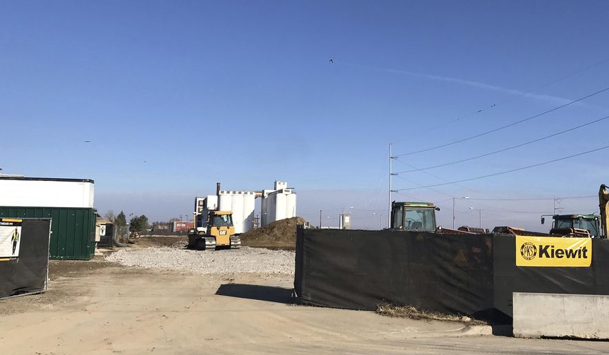 In this Friday, Nov. 16, 2018, photo a bulldozer moves gravel at the site of a future new shelter at Siena-Francis House, in Omaha, Neb. (Christopher Burbach/Omaha World-Herald via AP)
