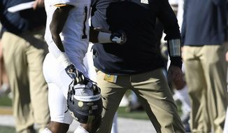 Pittsburgh's V'Lique Carter (19) gets encouragement from head coach Pat Narduzzi as he goes to the sideline during the second half of their NCAA college football game against Wake Forest on Saturday, Nov. 17, 2018, in Winston-Salem, N.C. (AP Photo/Woody Marshall)