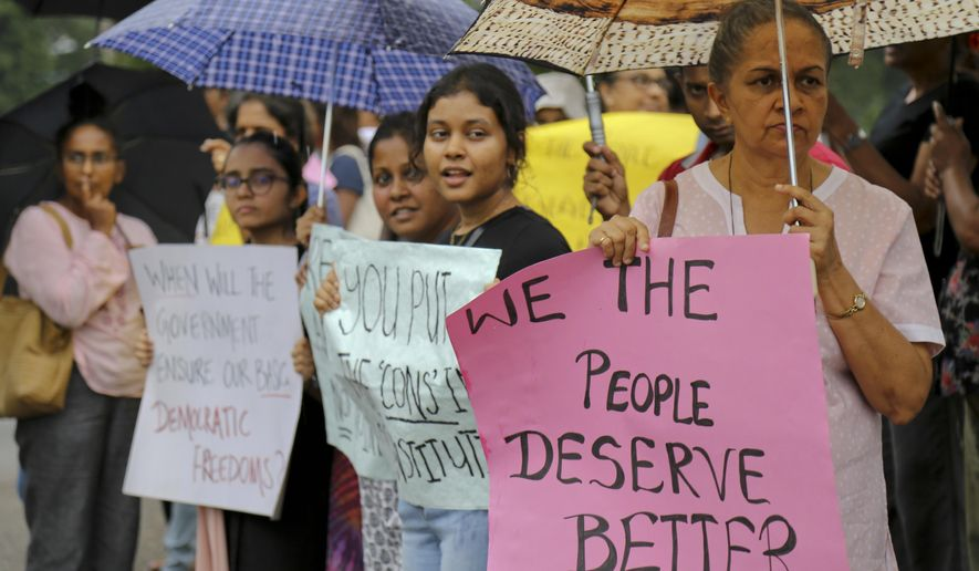 Civil society groups and activists hold placards during a protest demanding that democracy be restored in the country as they gather at the Independence Square in Colombo , Sri Lanka, Monday, Nov. 19, 2018. Sri Lanka has been in crisis since Oct. 26, when President Maithripala Sirisena abruptly fired Prime Minister Ranil Wickremesinghe and appointed Rajapaksa, a former president. Wickremesinghe has said he still has the support of a majority in Parliament. (AP Photo/Rukmal Gamage)