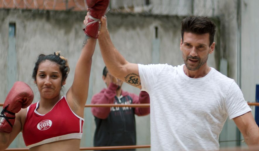 """This image released by Netflix shows actor and self-described fight enthusiast, Frank Grillo, right, in a scene from """"FightWorld,"""" a docu-series that follows Grillo as he goes globe-trotting to explore fighting styles and the cultures behind them. (Netflix via AP)"""