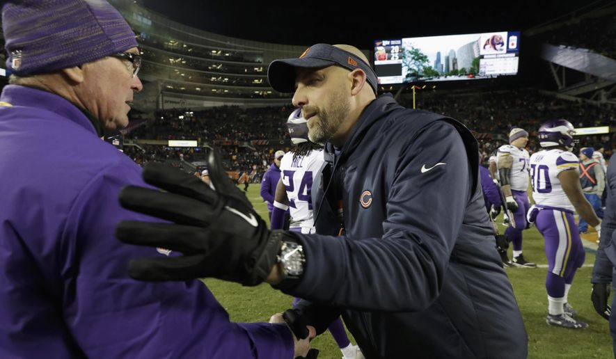 Chicago Bears head coach Matt Nagy, right, greets Minnesota Vikings head coach Mike Zimmer after their NFL football game Sunday, Nov. 18, 2018, in Chicago. The Bears won 25-20. (AP Photo/Nam Y. Huh)