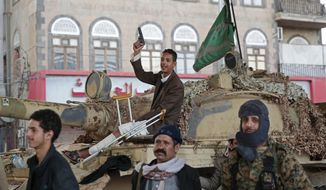 In this Dec. 4, 2017, file photo, Houthi Shiite fighters guard a street leading to the residence of former Yemeni President Ali Abdullah Saleh, in Sanaa, Yemen. (AP Photo/Hani Mohammed, File)