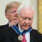 President Donald Trump awards Sen. Orrin Hatch, R-Utah, the Medal of Freedom during a ceremony in the East Room of the White House in Washington, Friday, Nov. 16, 2018. (AP Photo/Andrew Harnik)