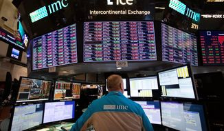 Stocks are skidding Tuesday as weak results from retailers and mounting losses for big technology companies push the market back into the red for the year. (ASSOCIATED PRESS)