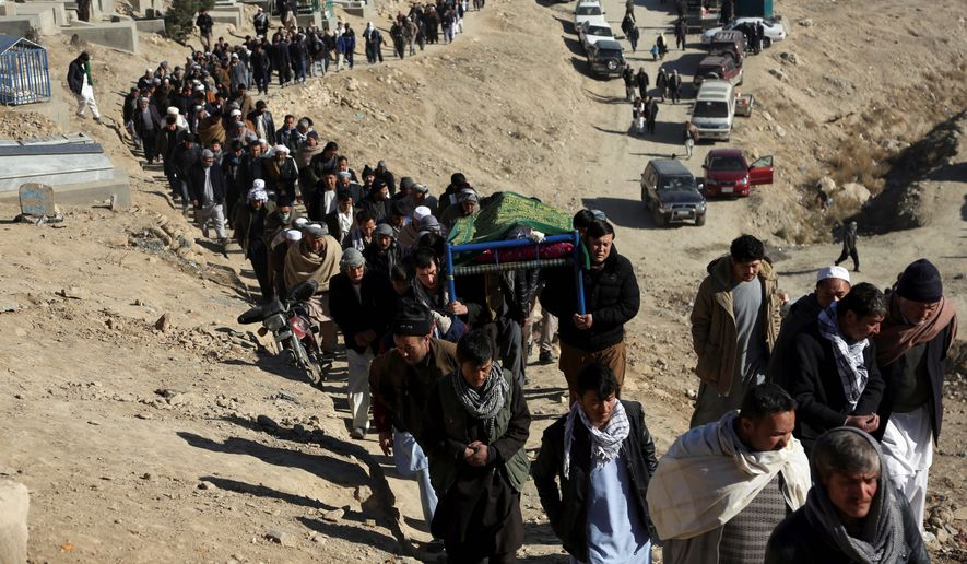 People carry the coffin of a relative who died in Thursday's suicide attack on a Shiite cultural center in Kabul, Afghanistan, Friday, Dec. 29, 2017. An Islamic State suicide bomber has struck a Shiite cultural center in Kabul, killing dozens of people and underscoring the extremist group's growing reach in Afghanistan even as its self-styled caliphate in Iraq and Syria has been dismantled. (AP Photo/Rahmat Gul)