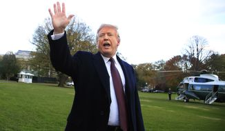 President Donald Trump waves after speaking to the media before leaving the White House in Washington, Tuesday, Nov. 20, 2018, to travel to Florida, where he will spend Thanksgiving at Mar-a-Lago. (AP Photo/Manuel Balce Ceneta)