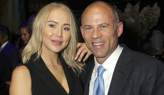 "In this September 2018 photo, attorney Michael Avenatti, right, poses with Mareli Miniutti for a photo at a party in New York. Miniutti alleges that Avenatti dragged her across the floor of his Los Angeles apartment after an argument over money, according to court documents obtained Tuesday, Nov. 20, 2018, by The Associated Press. Avenatti, who was arrested the week before on a felony domestic violence charge, called the allegations ""completely false."" He's scheduled to appear in court in December 2018. (Marion Curtis/StarPix via AP)"