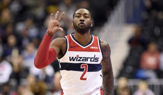 Washington Wizards guard John Wall (2) gestures after he made a three-point basket during the first half of an NBA basketball game against the Los Angeles Clippers, Tuesday, Nov. 20, 2018, in Washington. (AP Photo/Nick Wass)