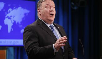 Secretary of State Mike Pompeo gestures while speaking during a news conference at the State Department in Washington, Tuesday, Nov. 20, 2018. (AP Photo/Pablo Martinez Monsivais)