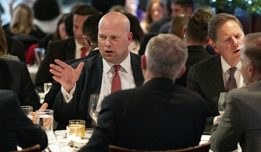 Acting U.S. Attorney General Matthew Whitaker, left, dines with other officials, Tuesday, Nov. 20, 2018, in New York. Before joining the Justice Department, Whitaker earned nearly $1 million from a right-leaning nonprofit that doesn't disclose its donors, according to financial disclosure forms released Tuesday. (AP Photo/Craig Ruttle)