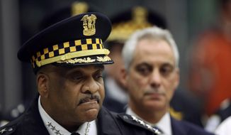 Chicago Police Superintendent Eddie Johnson, left, and Mayor Rahm Emanuel speak Monday, Nov. 19, 2018, during a news conference at the University of Chicago Medical Center, in Chicago, after a gunman opened fire at Mercy Hospital, killing a police officer and two hospital employees. (Chris Walker/Chicago Tribune via AP)