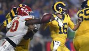 Kansas City Chiefs outside linebacker Justin Houston, left, strips the ball away from Los Angeles Rams quarterback Jared Goff (16) during the second half of an NFL football game, Monday, Nov. 19, 2018, in Los Angeles. Chiefs defensive end Allen Bailey recovered the ball and scored a touchdown. (AP Photo/Kelvin Kuo)