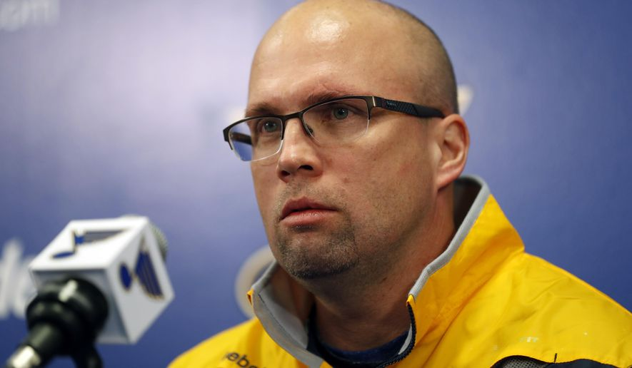 FILE - In this Feb. 1, 2017, file photo, Mike Yeo listens to a question during a news conference after being named the new head coach of the St. Louis Blues in St. Louis.  Early Tuesday, Nov. 20, 2018, Blues general manager Doug Armstrong announced that the team has fired Yeo and named Craig Berube as his interim replacement. (AP Photo/Jeff Roberson, File)