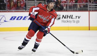 FILE - In this Oct. 19, 2018, file photo, Washington Capitals defenseman Brooks Orpik skates with the puck during the third period of an NHL hockey game against the Florida Panthers, in Washington. Orpik underwent arthroscopic surgery on his right knee and is expected to miss four to six weeks. The team announced the surgery and time frame Tuesday, Nov. 20, 2018. (AP Photo/Nick Wass, File)