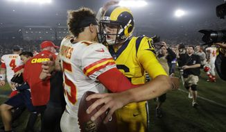 Los Angeles Rams quarterback Jared Goff, right, hugs Kansas City Chiefs quarterback Patrick Mahomes, left, after an NFL football game, Monday, Nov. 19, 2018, in Los Angeles. The Rams won 54-51. (AP Photo/Marcio Jose Sanchez)
