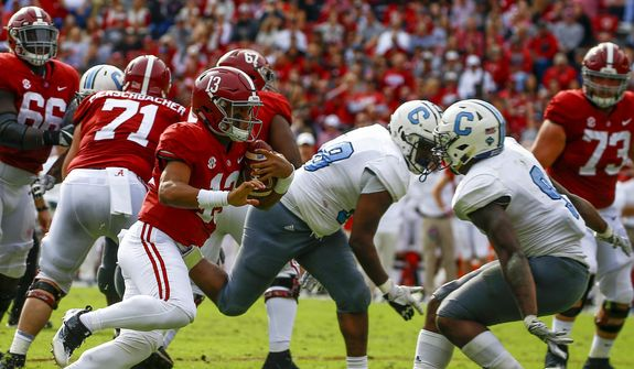 Alabama quarterback Tua Tagovailoa (13) carries the ball as he tries to get around Citadel linebacker Willie Eubanks III (9) during the second half of an NCAA college football game, Saturday, Nov. 17, 2018, in Tuscaloosa, Ala. (AP Photo/Butch Dill) **FILE**