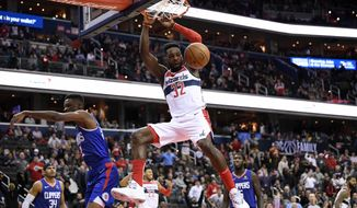 Washington Wizards forward Jeff Green (32) dunks against Los Angeles Clippers forward Tobias Harris (34), guard Shai Gilgeous-Alexander (2), and forward Montrezl Harrell, back right, during the second half of an NBA basketball game, Tuesday, Nov. 20, 2018, in Washington. The Wizards won 125-118. (AP Photo/Nick Wass)