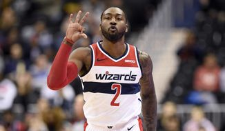 Washington Wizards guard John Wall (2) gestures after he made a three-point basket during the first half of an NBA basketball game against the Los Angeles Clippers, Tuesday, Nov. 20, 2018, in Washington. (AP Photo/Nick Wass) ** FILE **