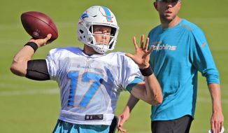Miami Dolphins quarterback Ryan Tannehill (17) throws during NFL football practice, Tuesday, Nov. 20, 2018, in Davie, Fla. (Al Diaz/Miami Herald via AP)