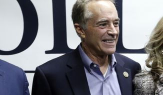 FILE- In this Nov. 6, 2018 file photo, Rep. Chris Collins, R-N.Y., poses for photographs after speaking with the media in New York. On Tuesday, Nov. 20, 2018, a campaign spokeswoman said that Collins declared victory over Democratic challenger Nate McMurray. Collins led by 3,000 votes Nov. 6, but the race was considered too close to call. (AP Photo/Frank Franklin II, File)