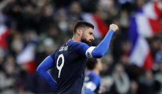 France's Olivier Giroud celebrates scoring the opening goal on a penalty kick during an international friendly soccer match between France and Uruguay at the Stade de France stadium in Saint-Denis, outside Paris, Tuesday, Nov. 20, 2018. (AP Photo/Francois Mori)